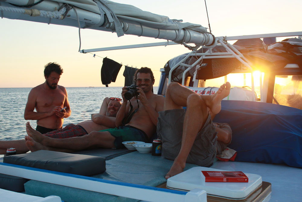 Chilling on deck aboard Sri Noa Noa after another epic surf session.