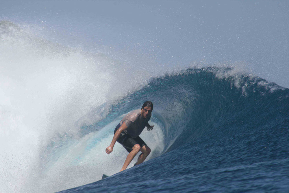 One of our happy guests getting barreled. Surf boat charter Sri Noa Noa