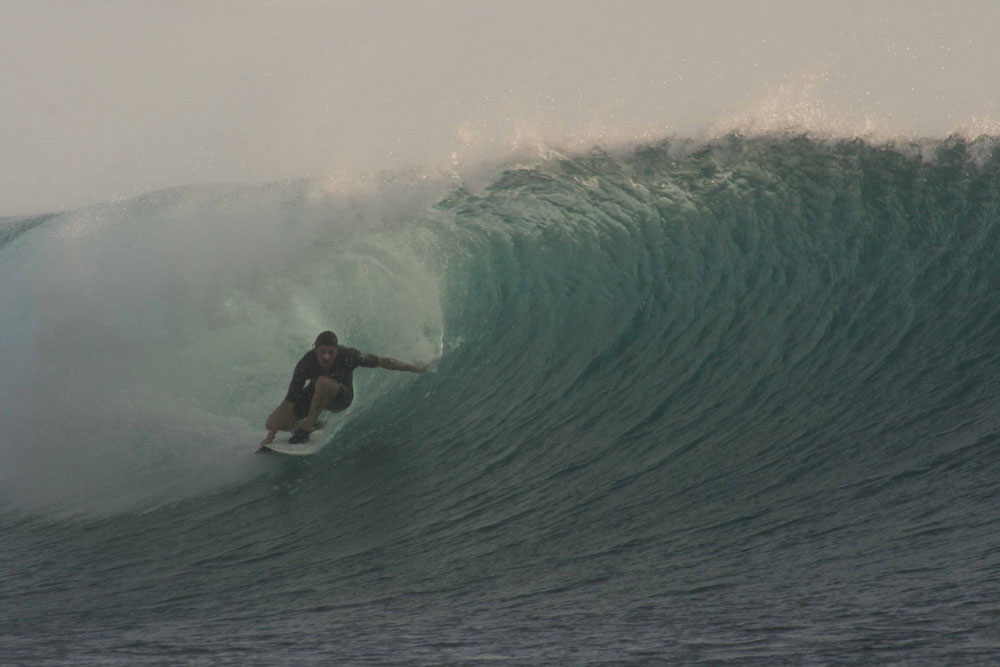 Surfer charging hollow waves in Sumbawa, aboard surf charter vessel Sri Noa Noa. Waves for every level and age